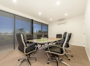 Executive style chairs around a boardroom table
